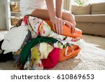 happy young woman in colorful... | Shutterstock . vector #610869653