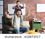 father and son watching... | Shutterstock . vector #610873517