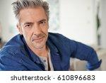 portrait of mature man relaxing ...   Shutterstock . vector #610896683