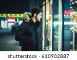 young man walking at night and... | Shutterstock . vector #610902887