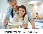 daddy with daughter baking cake ... | Shutterstock . vector #610903367