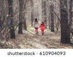 two little sisters walk in a... | Shutterstock . vector #610904093