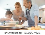 family cooking together in... | Shutterstock . vector #610907423