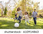 family playing soccer in park... | Shutterstock . vector #610914863