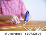 glue gun in the child's hand.... | Shutterstock . vector #610922603