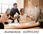 coworkers looking at a computer ...   Shutterstock . vector #610931243