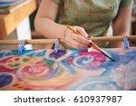 hand of female artist painting... | Shutterstock . vector #610937987