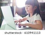 little asian girl  using laptop ... | Shutterstock . vector #610941113