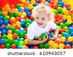 happy laughing boy having fun... | Shutterstock . vector #610943057