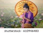 girl thai farmer grow lotus in... | Shutterstock . vector #610946483