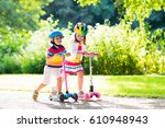 children learn to ride scooter... | Shutterstock . vector #610948943