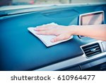 hand cleaning the car interior... | Shutterstock . vector #610964477