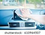 hand cleaning the car interior... | Shutterstock . vector #610964507