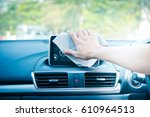 hand cleaning the car interior... | Shutterstock . vector #610964513