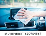 hand cleaning the car interior... | Shutterstock . vector #610964567