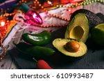 fiesta  cut avocado with... | Shutterstock . vector #610993487