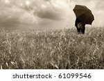 man watching the storm under umbrella - stock photo