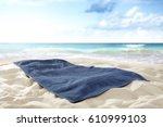 towel on beach of free space...   Shutterstock . vector #610999103