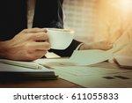 business man hand holding... | Shutterstock . vector #611055833