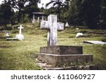 old cemetery with a big cross.  | Shutterstock . vector #611060927