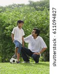 a father and son play soccer... | Shutterstock . vector #611094827
