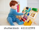 cute toddler baby playing with... | Shutterstock . vector #611112593