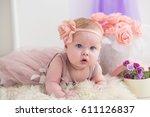 little baby girl in a beautiful ... | Shutterstock . vector #611126837