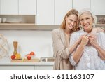 cheerful woman embracing her... | Shutterstock . vector #611163107