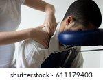businessman receiving shiatsu... | Shutterstock . vector #611179403