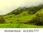 yellow and green colored hills... | Shutterstock . vector #611201777