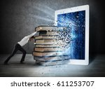 reading books with an e book | Shutterstock . vector #611253707