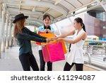 women are arguing shopping bag. | Shutterstock . vector #611294087