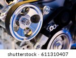 an engine of a modern car. | Shutterstock . vector #611310407