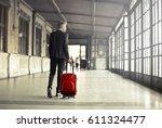 businessman leaving the city... | Shutterstock . vector #611324477