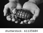 Man Holding An Old Hand Grenad...