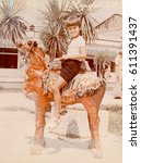 Small photo of USSR, ABKHAZIA, SUKHUMI - CIRCA 1983: Vintage photo of little boy on toy camel