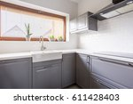 Light Kitchen With Flowers And...
