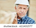 senior as old craftsman with... | Shutterstock . vector #611431577