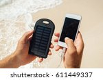 charger solar in the hands of... | Shutterstock . vector #611449337