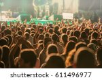 crowd of fans during a rock... | Shutterstock . vector #611496977
