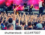fans during a rock band concert.... | Shutterstock . vector #611497007