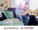 caucasian happy couple using... | Shutterstock . vector #611504087