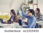 college students raising hands... | Shutterstock . vector #611525453