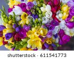 colorful bouquet of freesia... | Shutterstock . vector #611541773