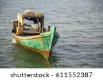 colorful wooden fishing boat in ... | Shutterstock . vector #611552387