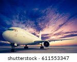 commercial airplane with sunset ... | Shutterstock . vector #611553347