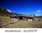 Old Wooden Hut Under The Blue...