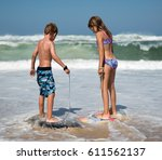 brother and sister playing with ... | Shutterstock . vector #611562137