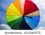 colorful umbrella and blue sky... | Shutterstock . vector #611564573