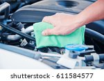 wipe cleaning the car engine... | Shutterstock . vector #611584577
